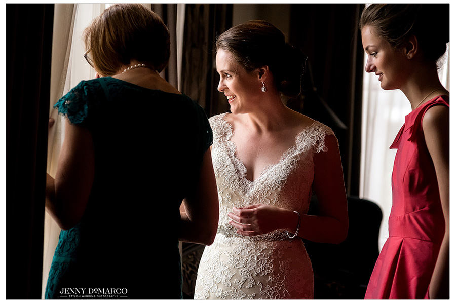 Sweet photo of bride and her mother looking out the window before getting married at Hotel Ella in Austin.