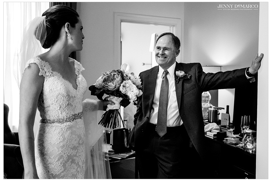 Father of the bride sees his daughter before they walk down the aisle.
