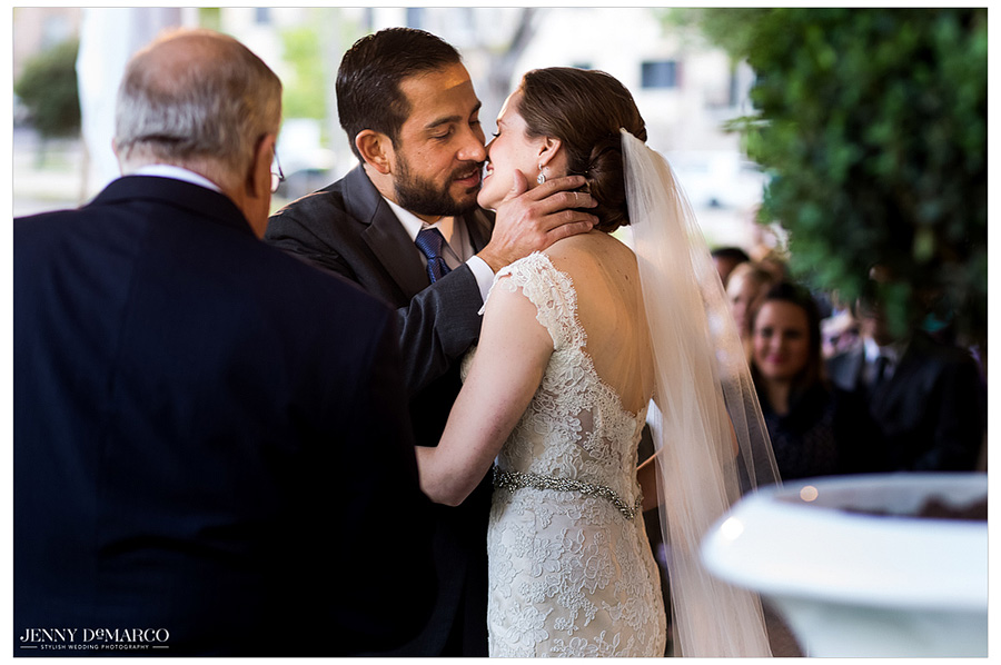 Bride and groom share a beautiful kiss during their Austin wedding ceremony.