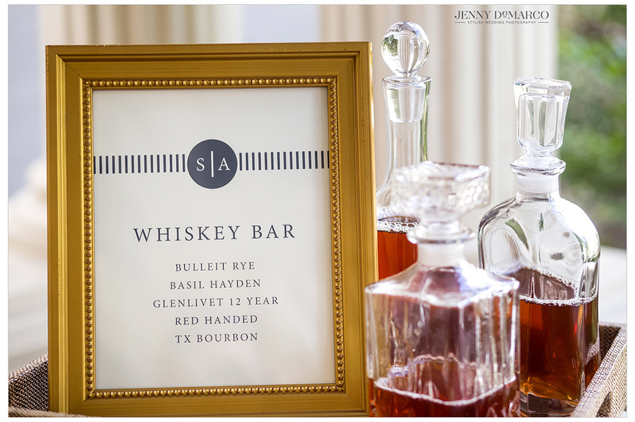 Photo taken of the whiskey bar available to guests at an Austin wedding.