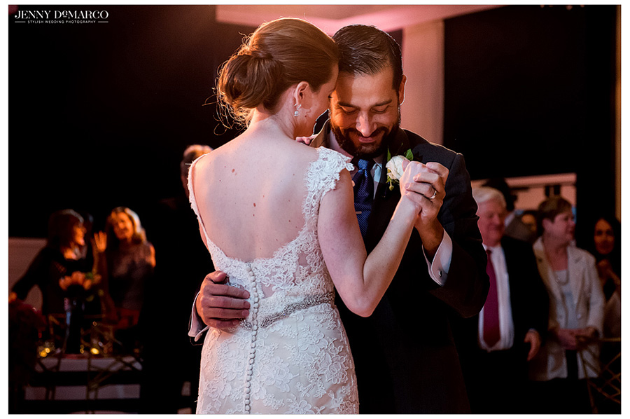 Bride and groom share their first dance together at reception.