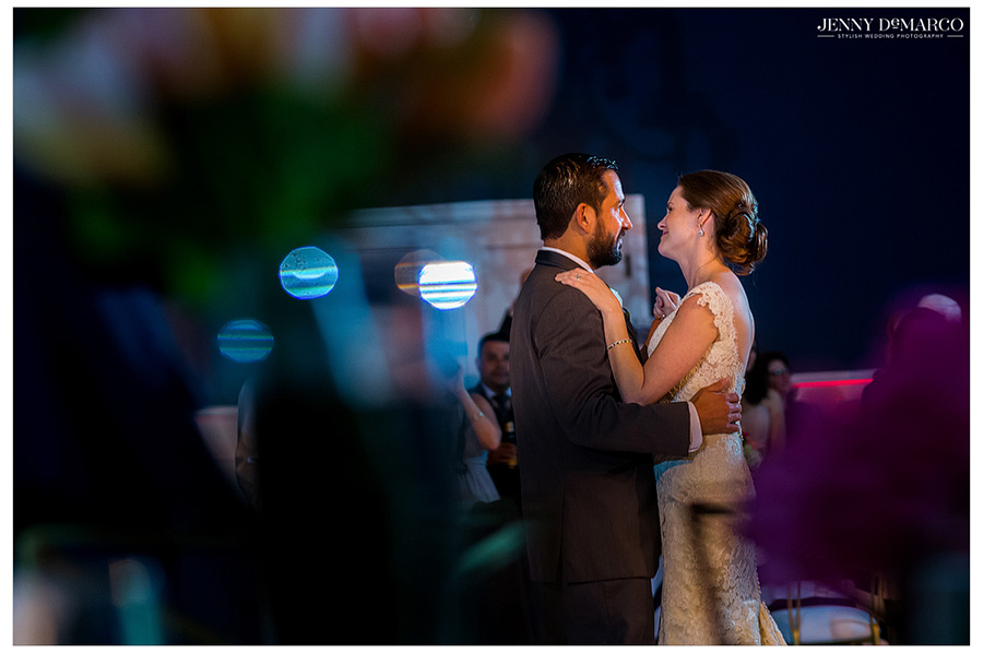 Bride and groom share a dance together during their romantic wedding reception in Austin.