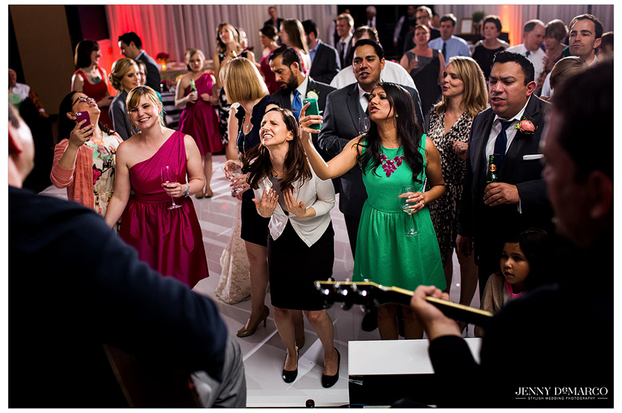 Guests go crazy over wedding band in Austin at Hotel Ella reception.