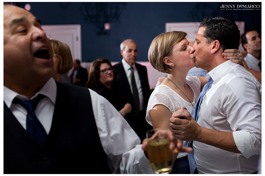 Guests at Hotel Ella wedding dance and share a kiss at the reception.