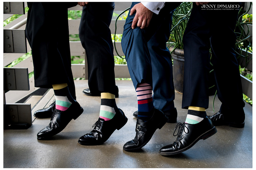 Groomsmen show off their crazy socks after getting ready for this small Austin wedding.