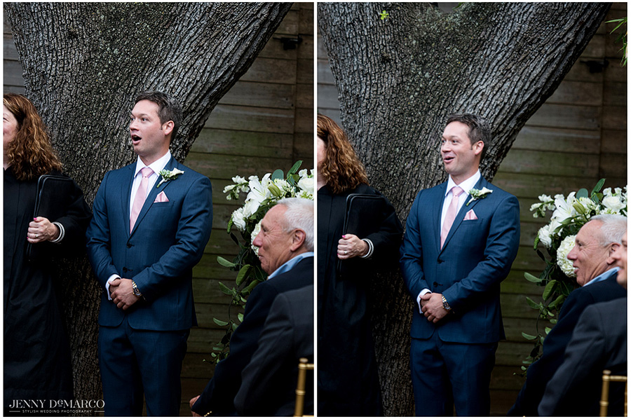 Stunned groom looks at his bride as she makes her way down the aisle.