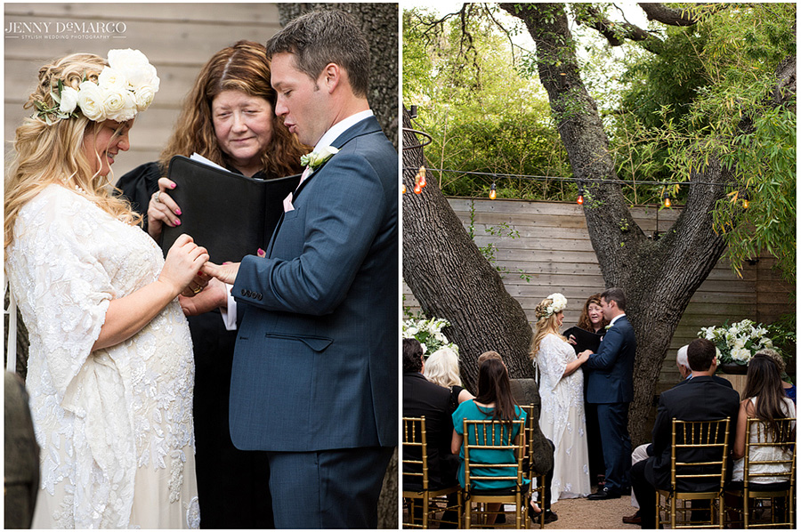 The pregnant bride and groom exchange vows under the trees in an intimate setting at Hotel St. Cecilia.