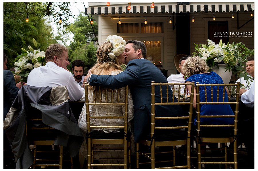 Bride and Groom share a kiss during their outdoor reception at Hotel St. Cecilia.