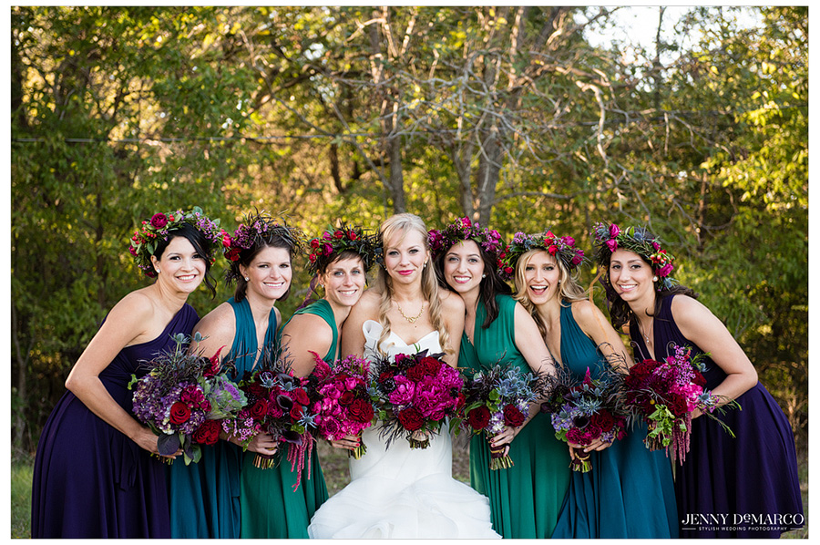 Bridesmaid with the bride in jewel tones and gorgeous flower crowns.