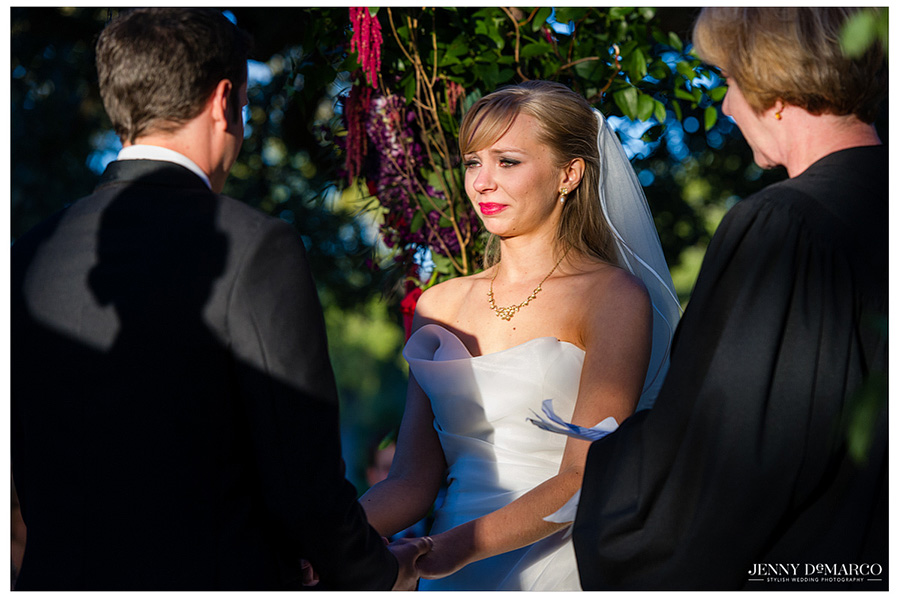 Beautiful bride tears up as she exchanges vows with her soon to be husband.