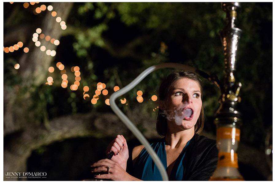 Great Austin wedding photographer captures wedding guest smoking hookah at reception.