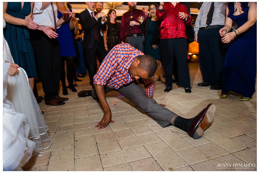 Guest at Polish wedding breaks into the splits on dance floor.