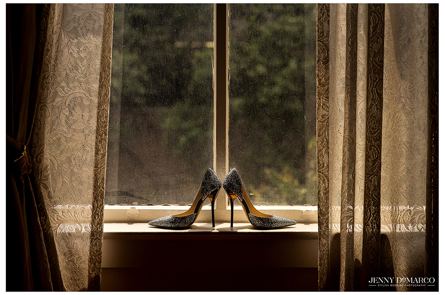 The bride's sparkly Jimmy Choos sit perched on the window sill as the bride gets ready.