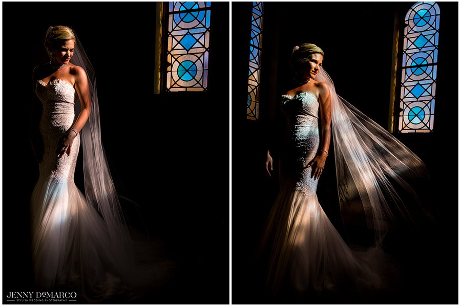 Lit up by the beautiful colors of a stained glass window, the bride calmly waits to walk down the aisle.