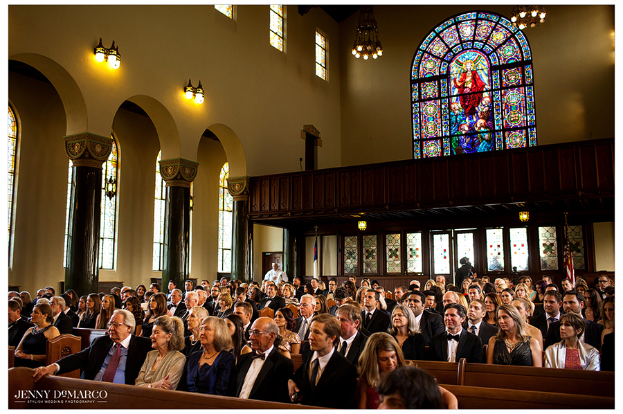 Family and friends of the bride and groom fill the pews of Central Christian Church as they wait for the ceremony to start.