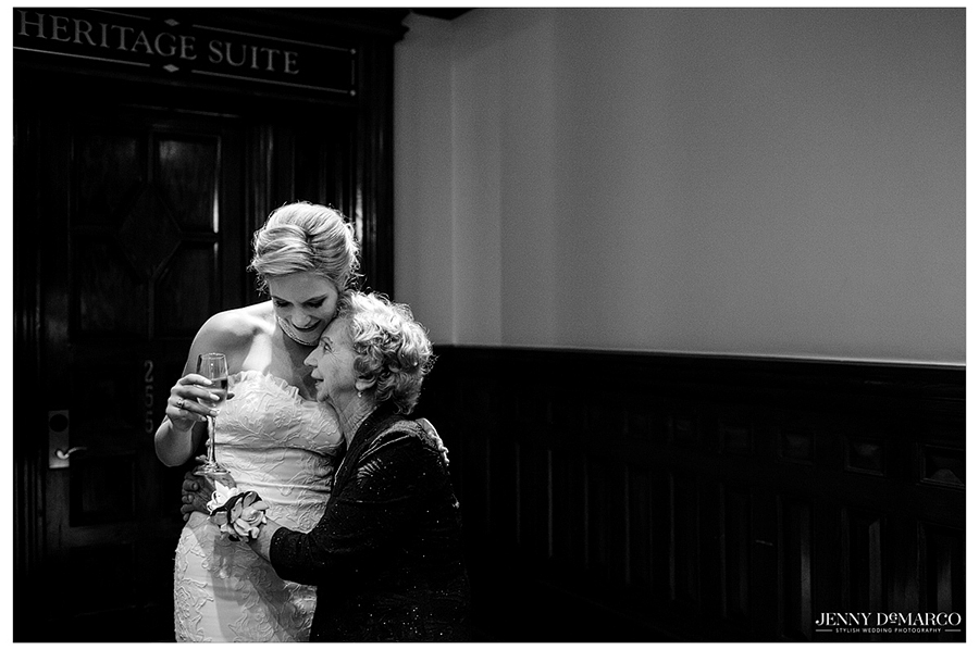 The bride shares a sweet moment with her grandmother as the reception begins.