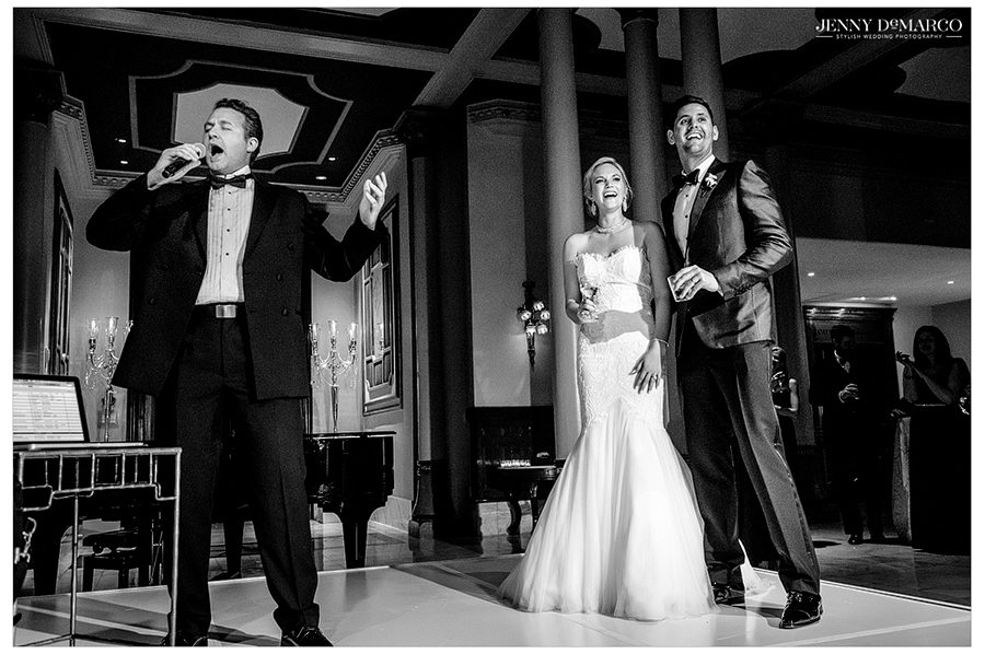 The bride and groom laugh along to a funny toast given by a close friend.