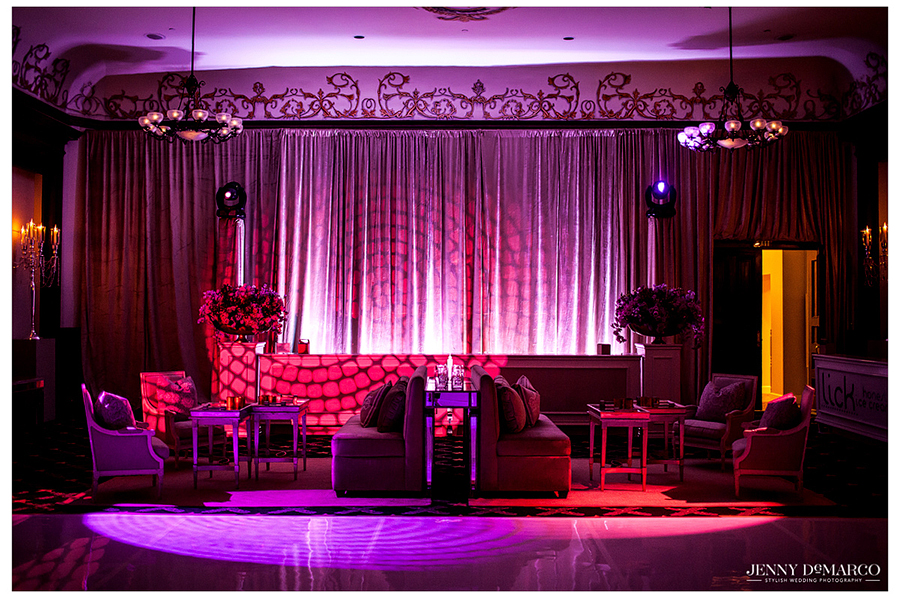 Purple uplighting with a gobo pattern gives this area of the ballroom a fun, modern feel.
