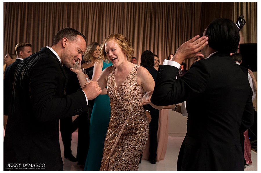 A redheaded friend of the couple shows off her dance moves during the reception.