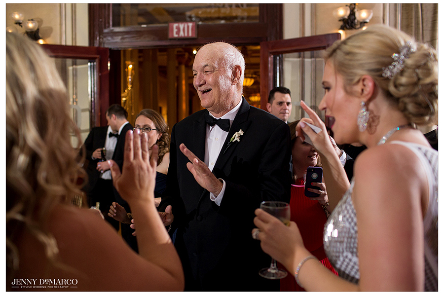 The father of the bride hits the dance floor to celebrate the bride and groom during the reception.
