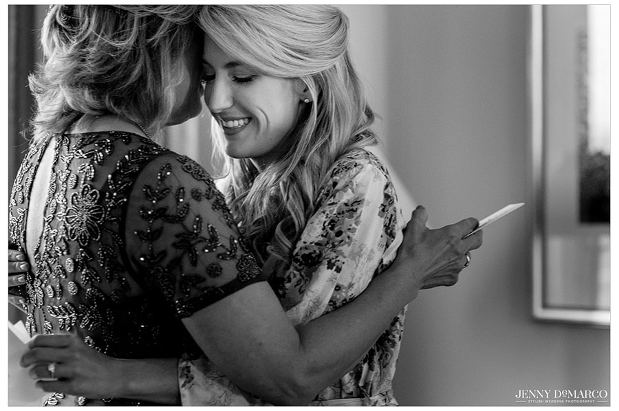 The bride hugs her mother after reading the emotional letter.