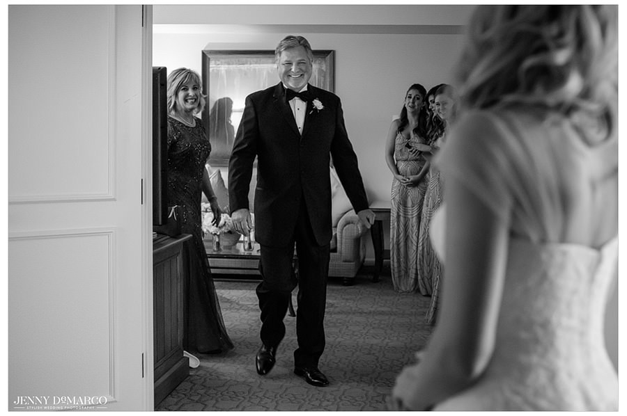 The father of the bride cannot hide his emotion as he sees his daughter for the first time.