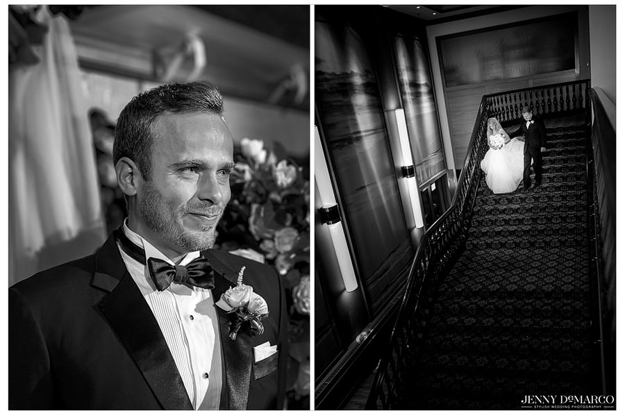 The groom waits anxiously as the bride and her father walk down the staircase to meet him.