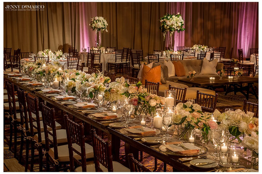 Flowers and candles line each table in the ballroom of the Four Seasons.