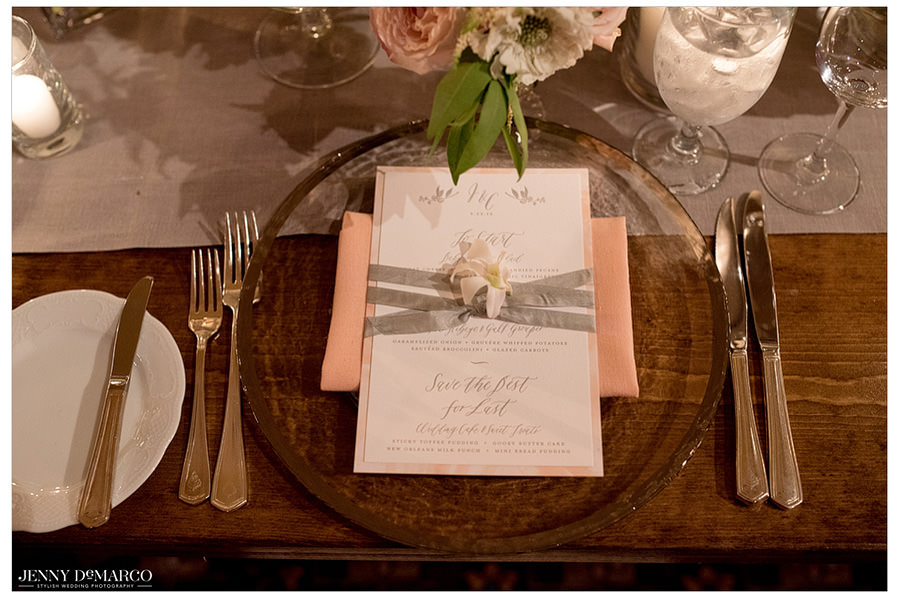Menus are elegantly displayed at each place setting.
