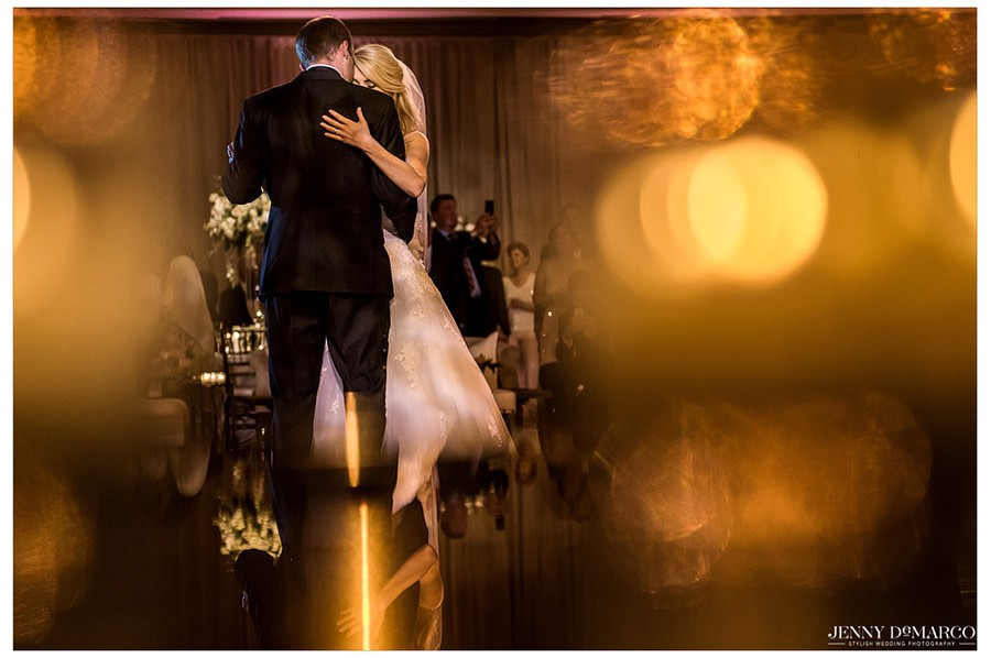 The bride and groom share a sweet moment during their first dance.