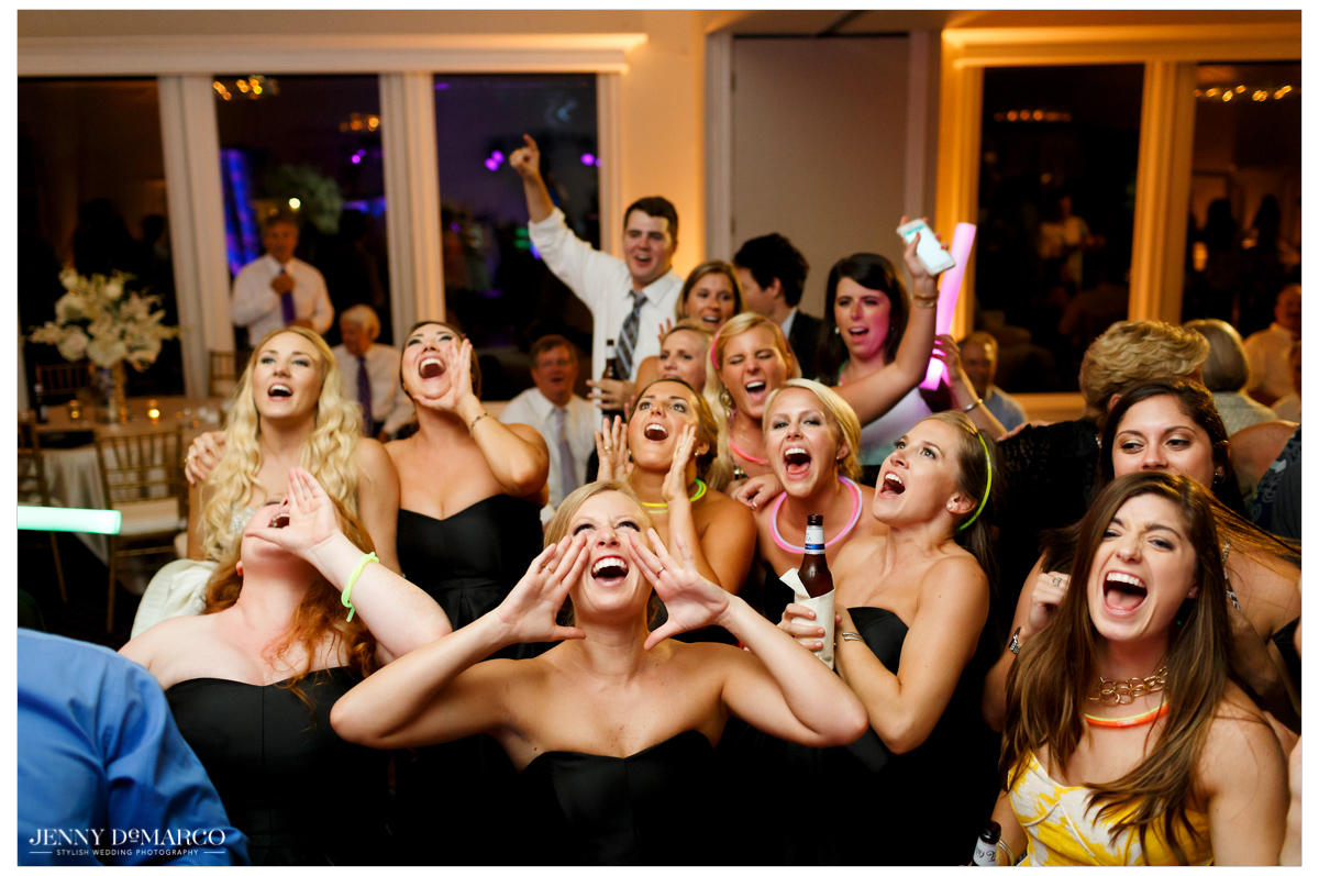 Bridesmaids hit the dance floor to celebrate the new couple.