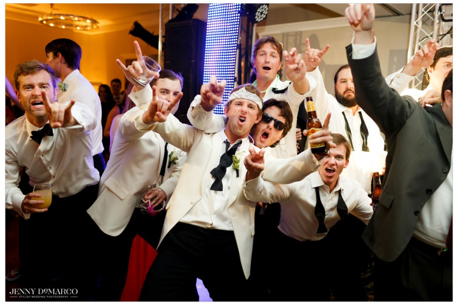 The groomsmen pose for a funny picture as the reception draws to a close.