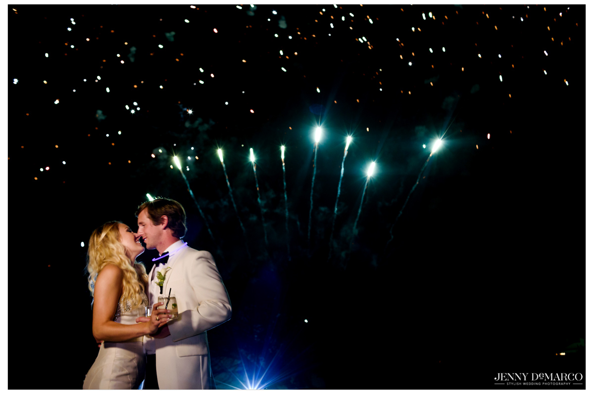 The bride and groom share a sweet moment during fireworks at the end of the reception.