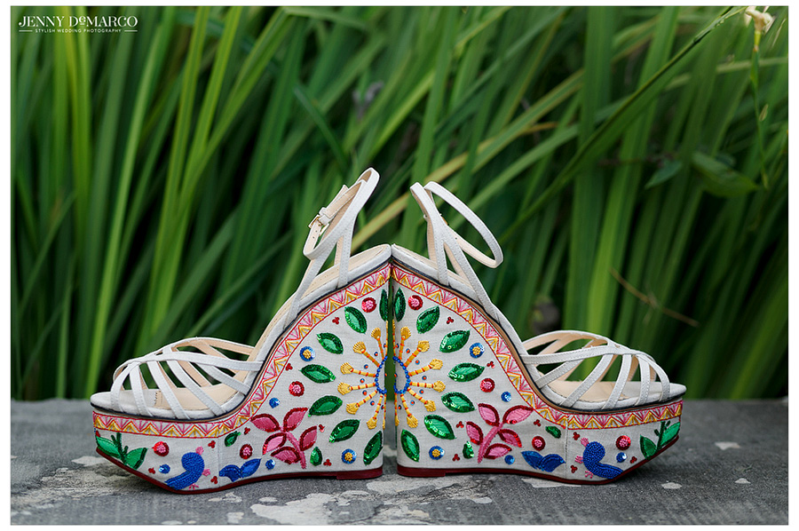 The bride's bright, Mexican-inspired floral shoes added a hidden pop of color to her white wedding outfit.