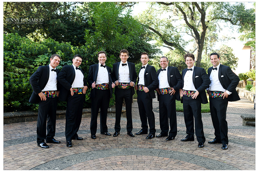 The groomsmen show off their bright, Mexican-inspired cummerbunds.