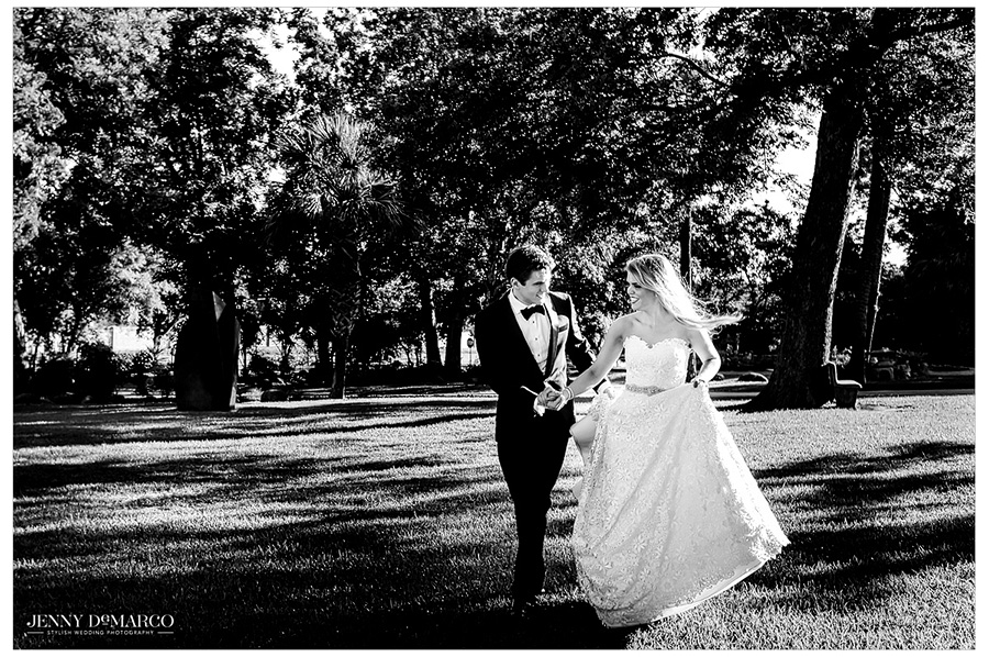 Black and white photo of the bride and groom outdoors.