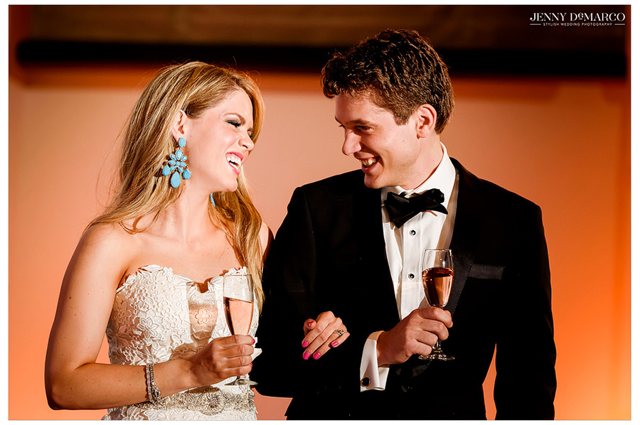 The bride and groom share a laugh during the toasts at the wedding reception.