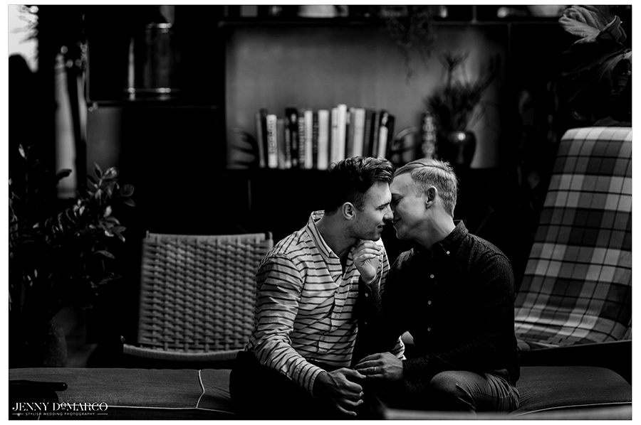 Austin gay couple kissing on the couch, engagement, at South Congress Hotel