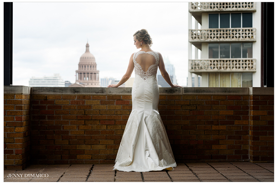 Portrait of the bride poising on a rooftop with the Austin skyline in the background.