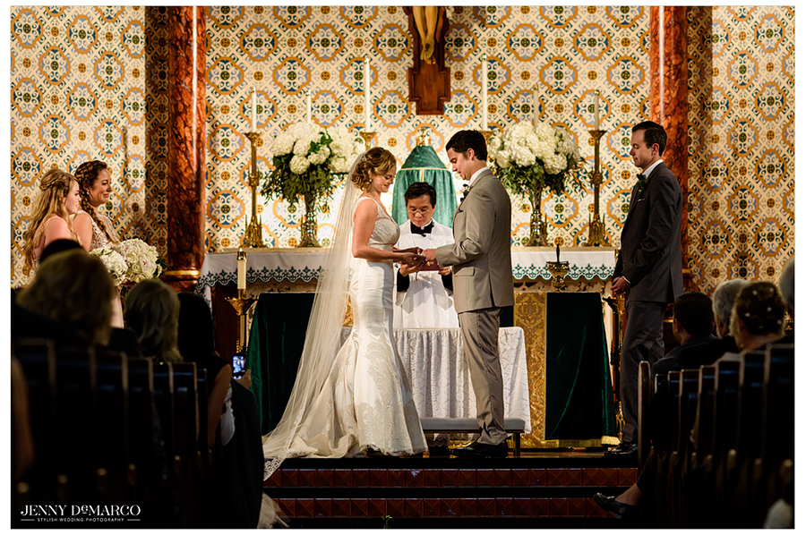 Photo of the bride and groom at the altar at St. Mary's Cathedral during the wedding ceremony.