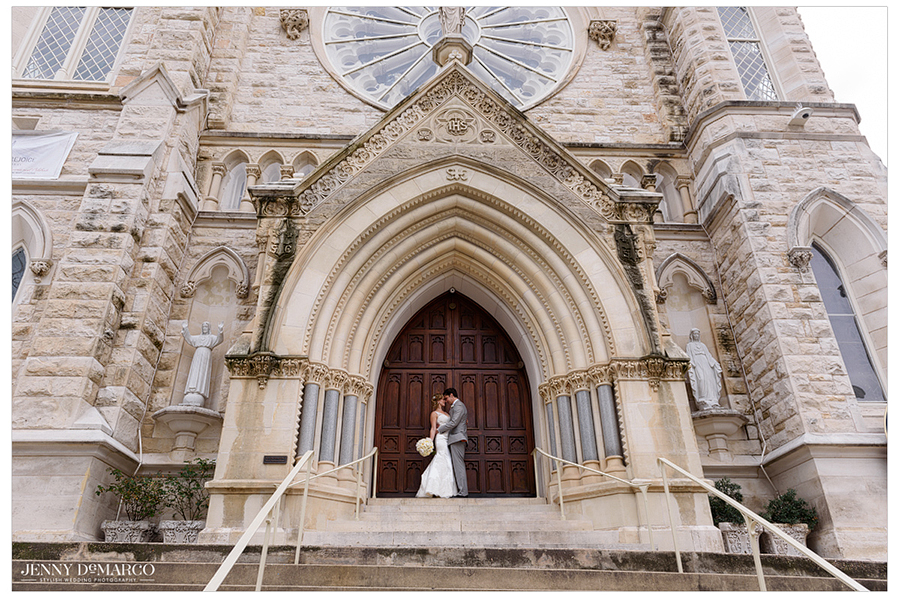 Portrait of the bride and groom in front of the doors of St. Mary's Cathedral.