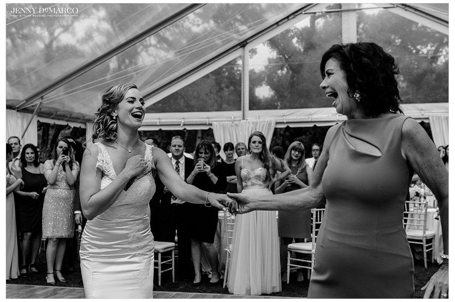 Black and white photo of the bride and her mother dancing together at the reception.