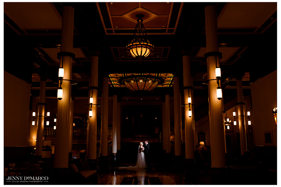 The bride and groom stand together in the Driskill Hotel.