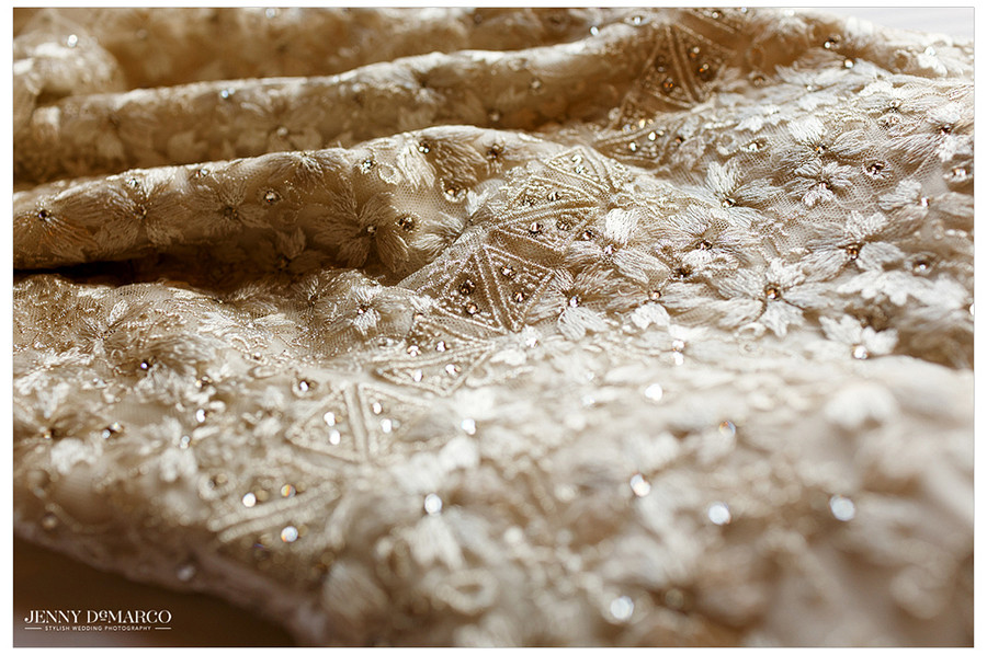 Photograph showing the lovely details of the bride's wedding dress.