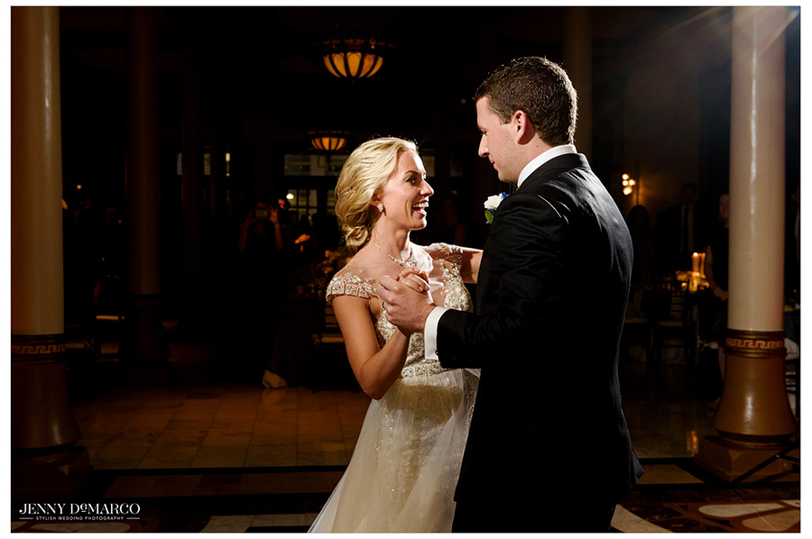 Close-up photo of the bride and groom dancing together at the Driskill Hotel at the wedding reception.