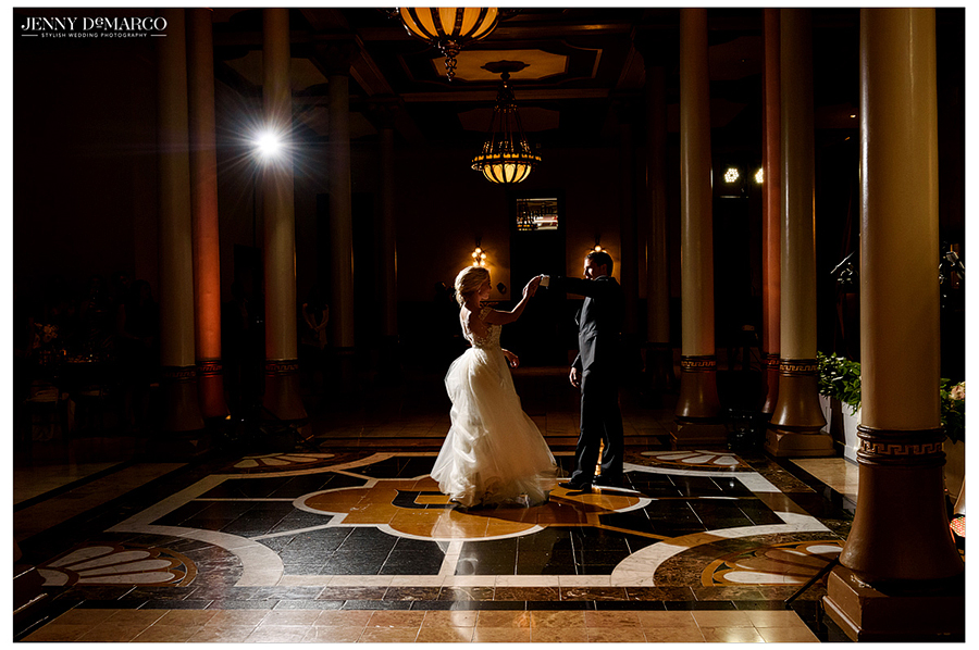 Photo of the bride and groom dancing together at the wedding reception at the Driskill Hotel.