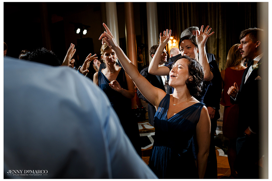 Photo of wedding guests dancing and having fun at the reception at the Driskill Hotel.