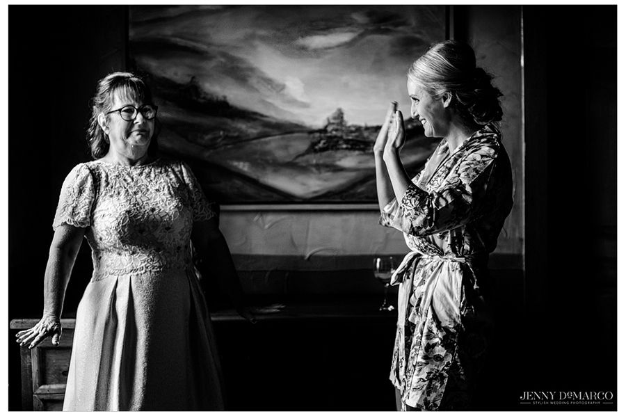 The bride and her Mother dancing while getting ready for the wedding.