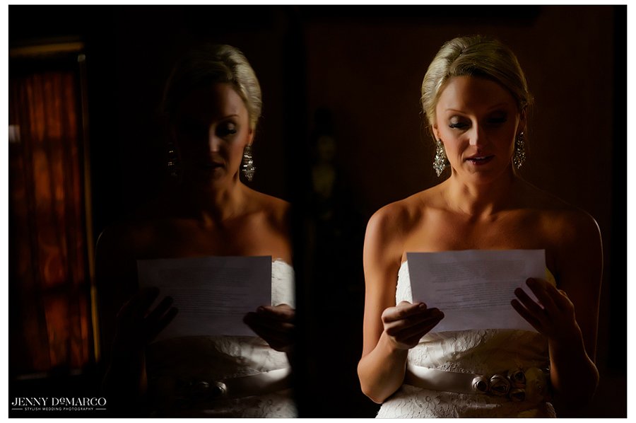 A mirror image of Amy while she reads her wedding vows after getting fully prepared in her dress.