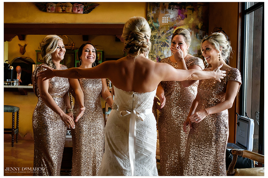 Amy giving her bridal party a first look at her entire appearance in the bridal sun room.